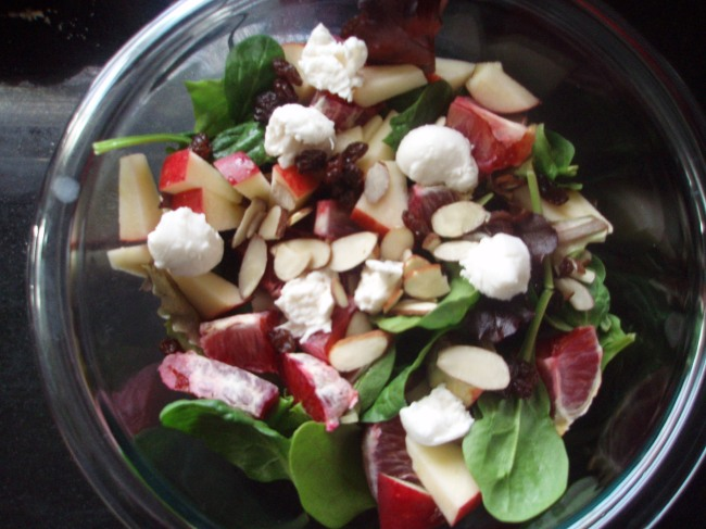 You are looking at the perfect salad I made myself for lunch. Mixed greens, spinach, raisins, sliced almonds, apples, blood oranges, mozzarella cheese, and vinegar and extra virgin olive oil.